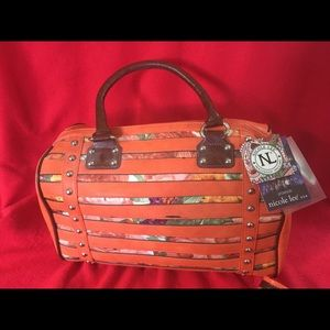 Nicole Lee orange handbag.